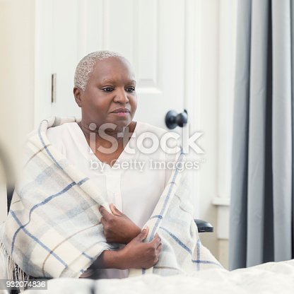 941439642 istock photo Depressed woman in nursing home 932074836