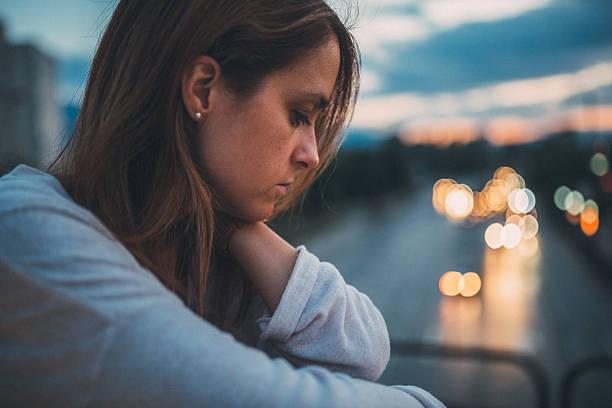 Depressed woman in the city bildbanksfoto
