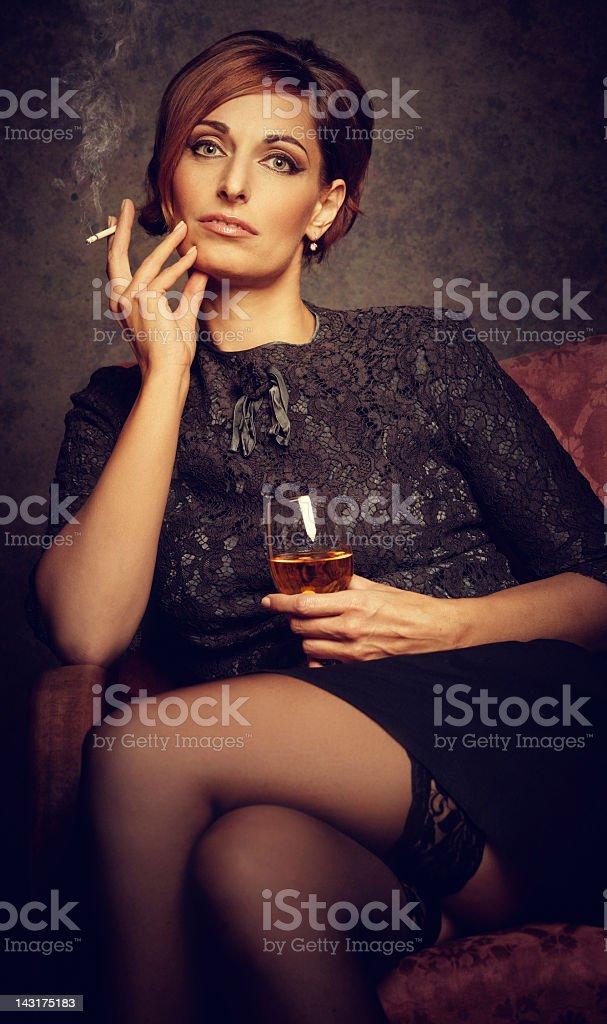 depressed woman smoking and drinking royalty-free stock photo
