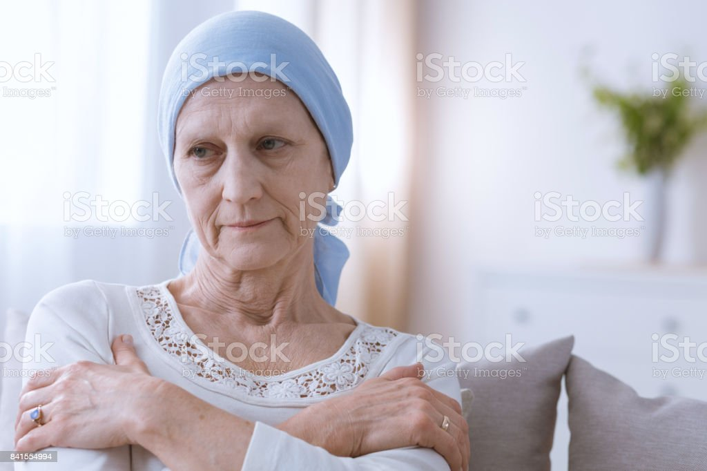 Depressed woman suffering from cancer stock photo