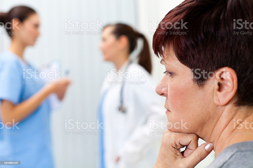 Depressed woman waiting in doctor's office royalty-free stock photo