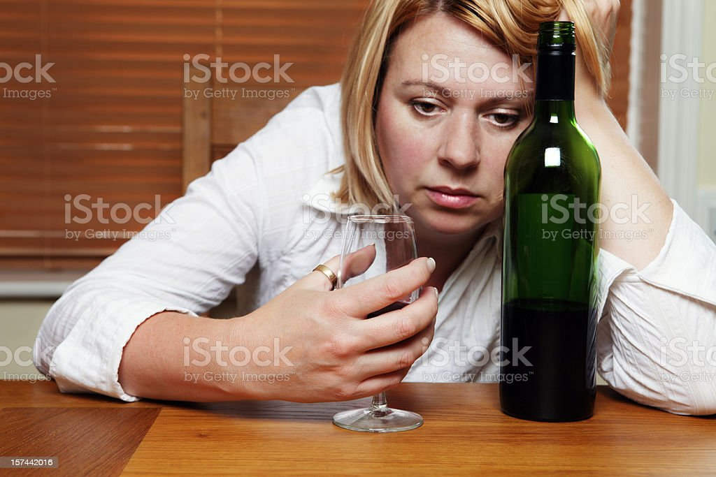 Depressed Woman with Red Wine stock photo