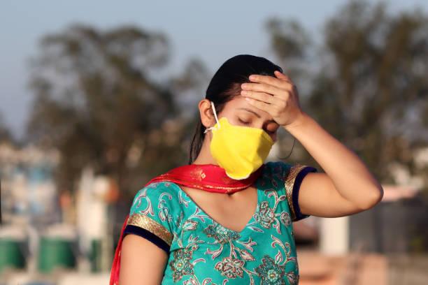 Depressed women against Lockdown and COVID-19, New Delhi, India stock photo