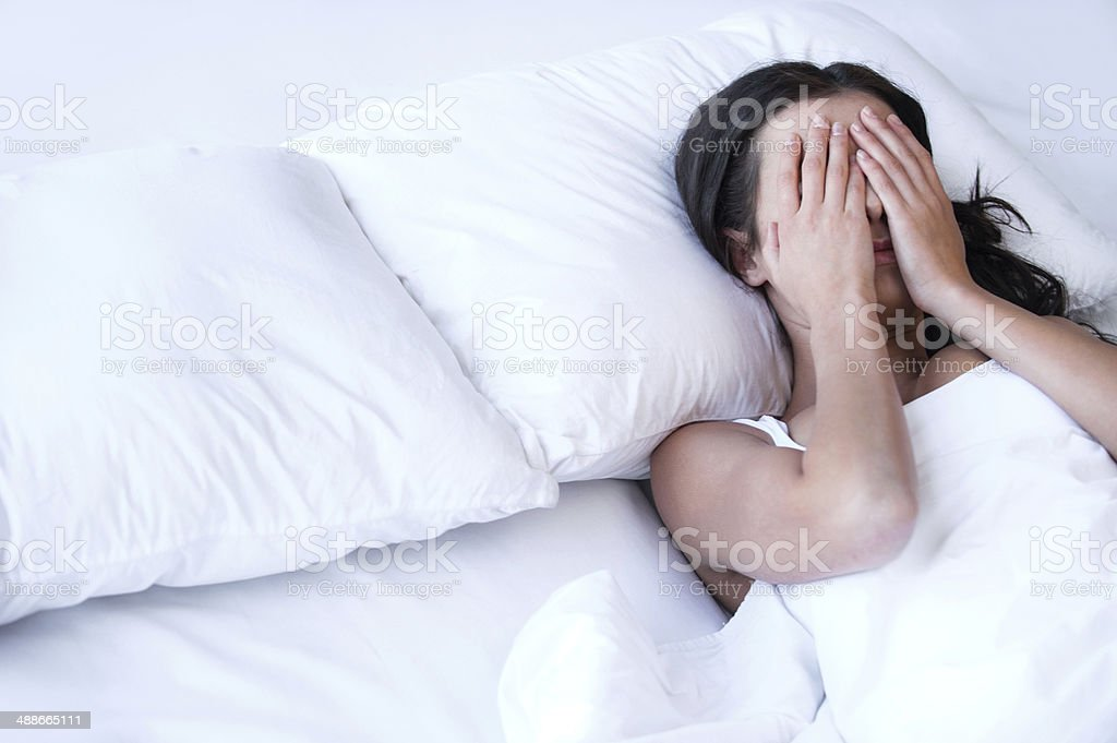 Depressed women in bed. stock photo