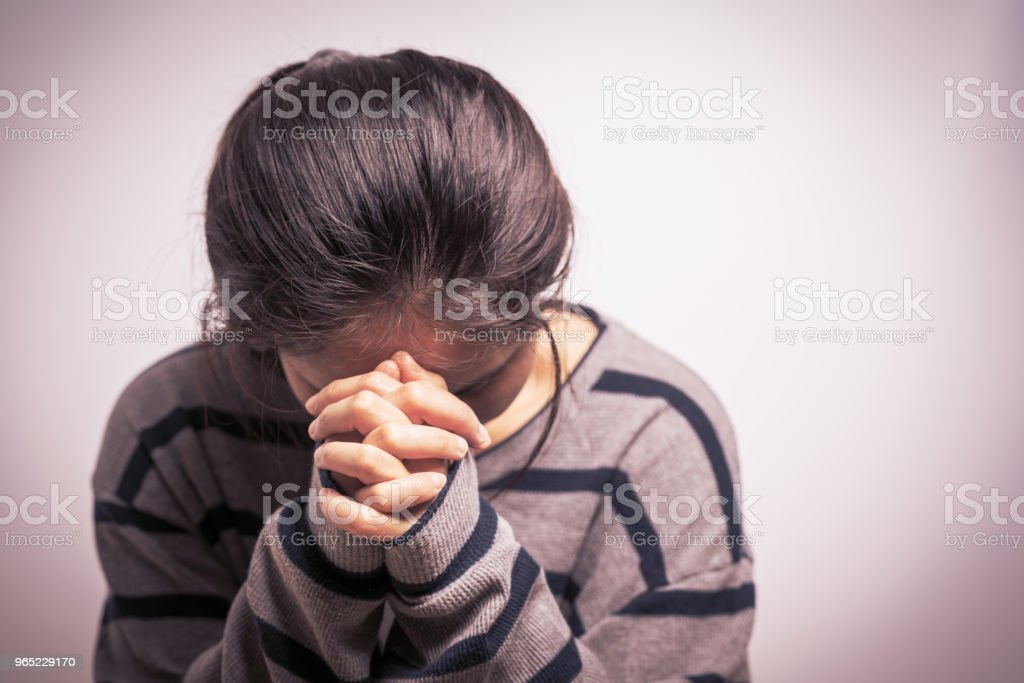 depressed women sitting in the dark room, alone, sadness, emotional concept royalty-free stock photo