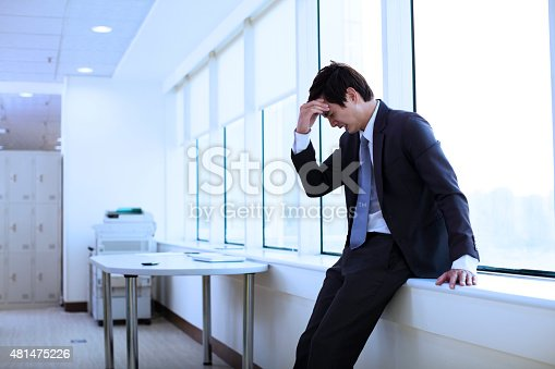 istock Depressed young businessman in office 481475226