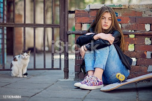 Depressed young girl, looking sad