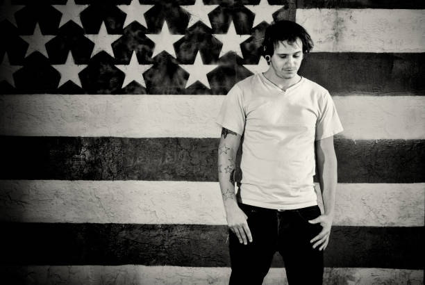 Depressed Young Man in America  american flag tattoos for men stock pictures, royalty-free photos & images