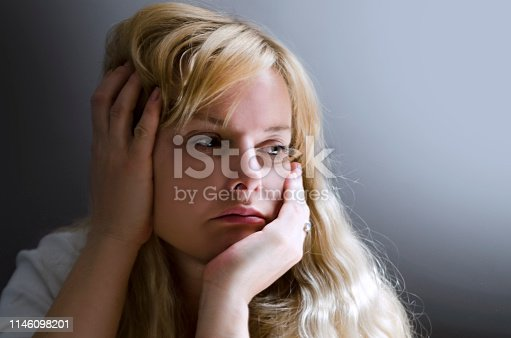 Blond pretty long hair female feeling anxious and sad