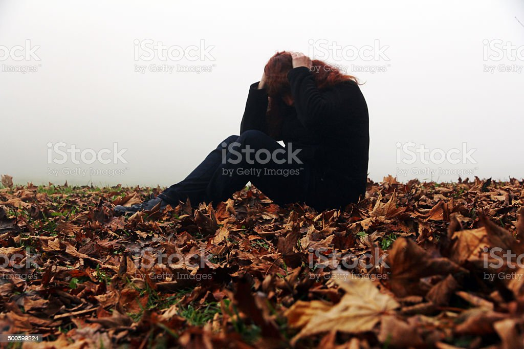 Depression, sadness and dejection in autumn stock photo