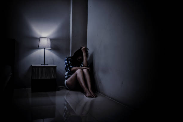 Depression woman alone in the dark room. Mental health problem, PTSD is Post-traumatic stress disorder. Depression woman alone in the dark room. Mental health problem, PTSD is Post-traumatic stress disorder. suicide stock pictures, royalty-free photos & images