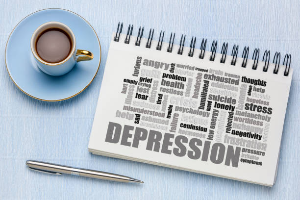 depression word cloud on tablet with coffee stock photo