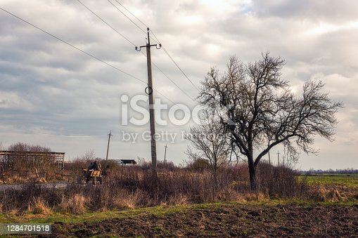 Depressive moody landscape, ruined and abandoned countryside, early spring