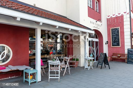 Garmisch, Germany; April 3, 2019: Der Laden natural store and restaurant exterior in downtown Garmisch, Germany.
