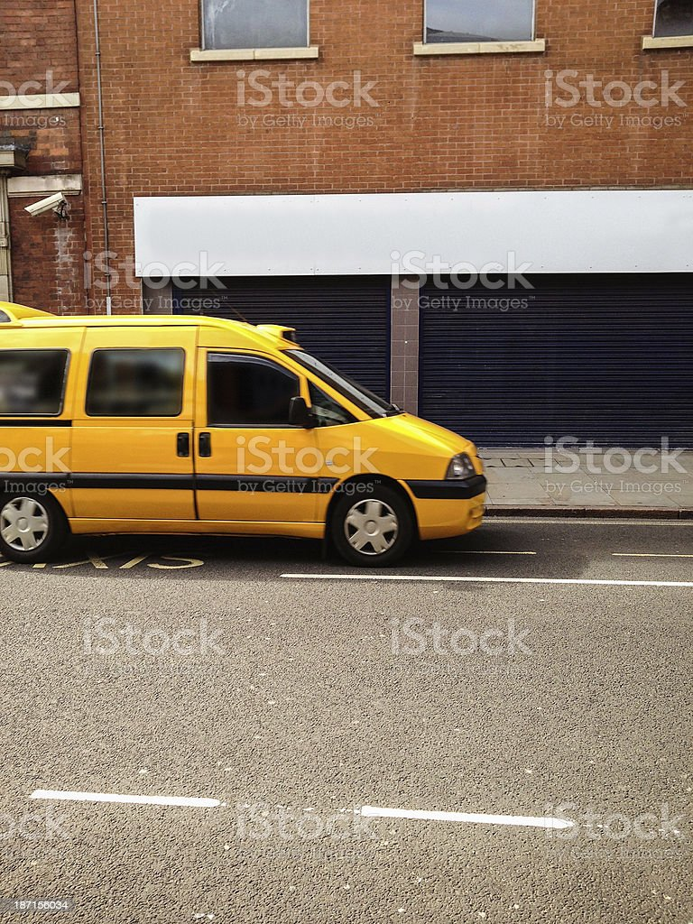 Derby yellow taxi - british culture stock photo