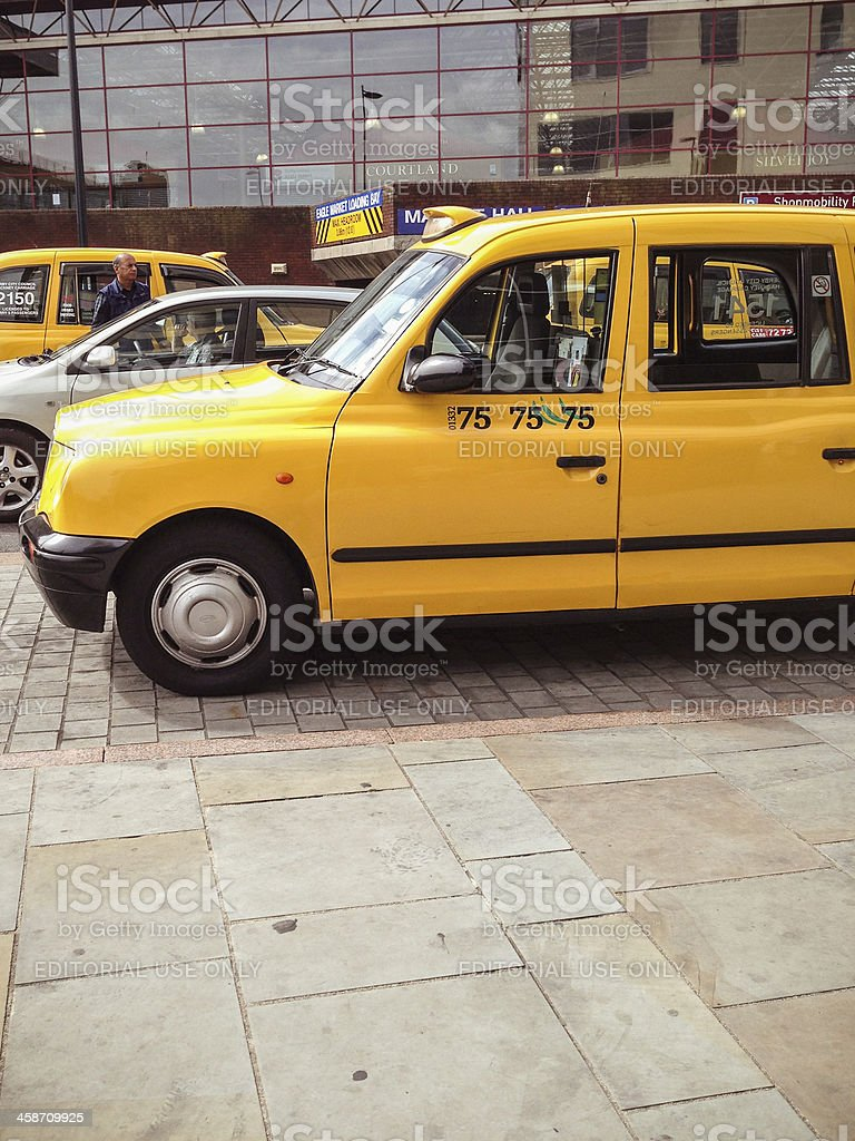 Derby yellow taxi - british culture royalty-free stock photo