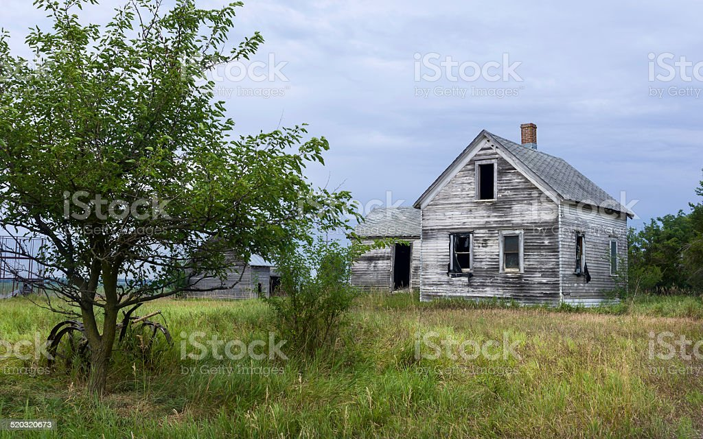 Derelict Abandoned House Surrounded By Vegetation Near Dover