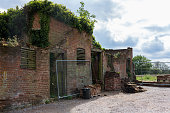 A derelict and dilapidated barn building that is getting prepared for restoration and converted in to a house