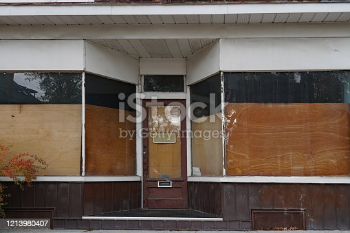 Derelict old store with boarded up windows