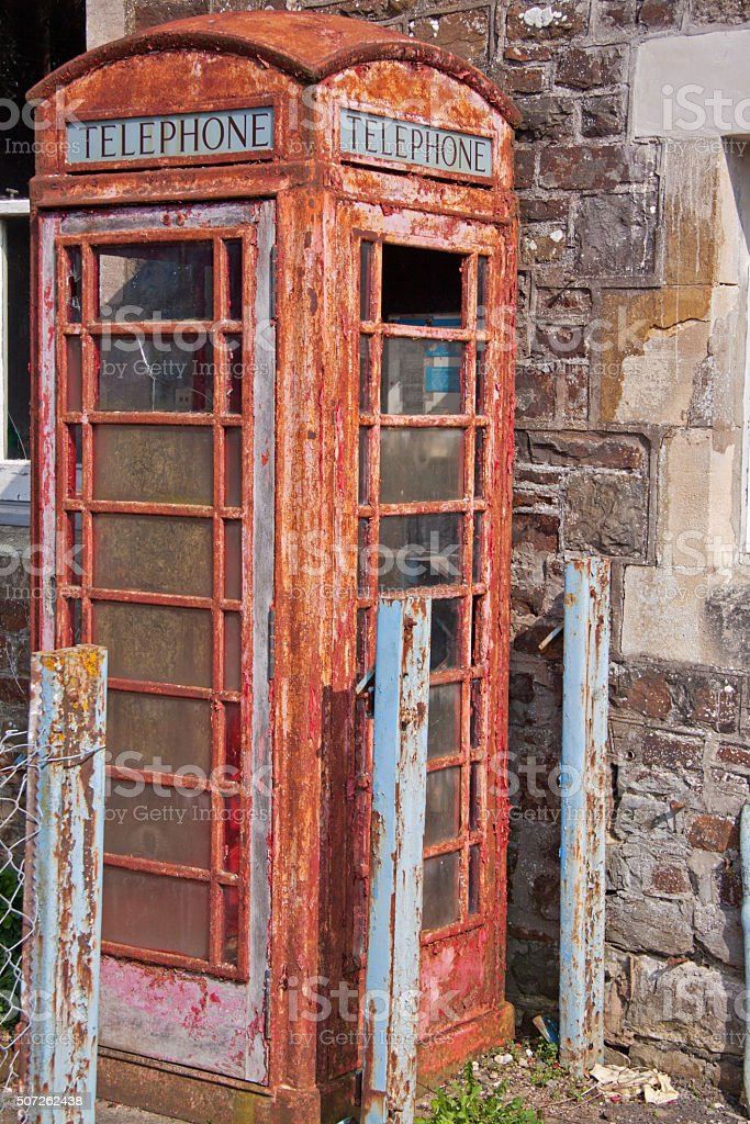 Derelict traditional red telephone box UK stock photo