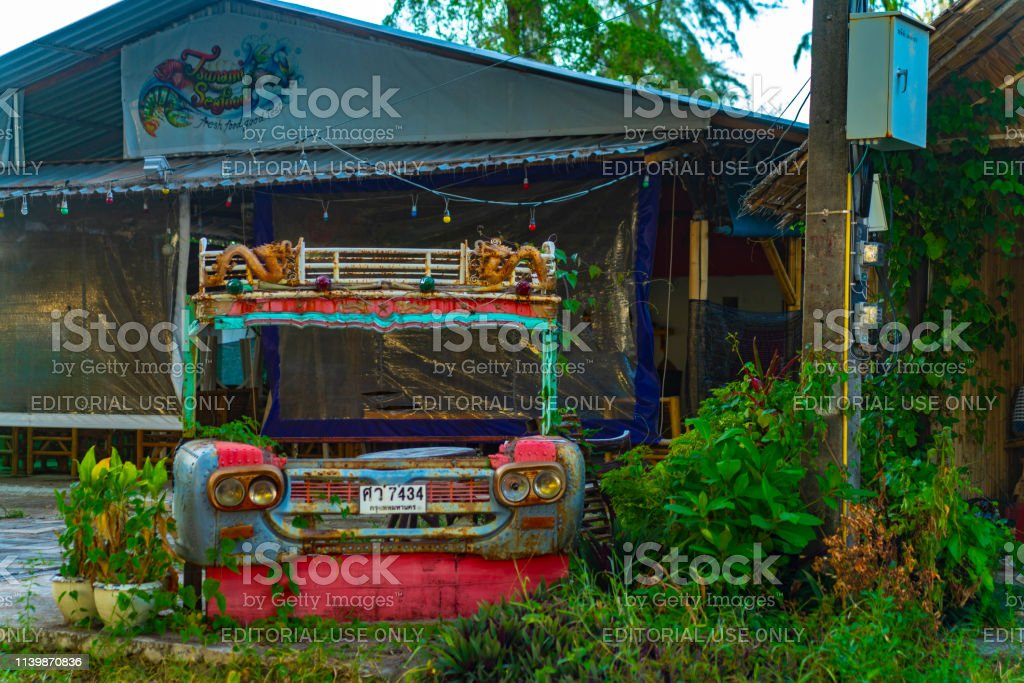 Derelict vehicle outside a disused Thailand hotel bar. There are...