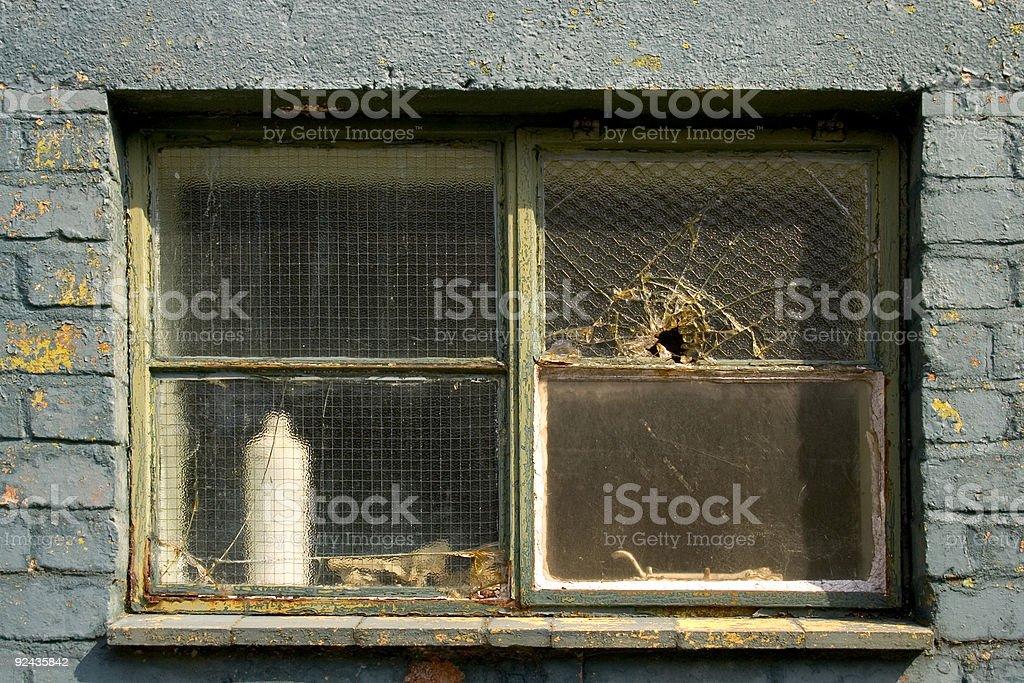 Derelict Window - bullet hole stock photo