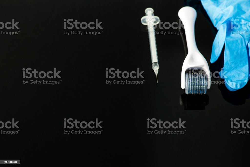 Dermaroller for medical micro needling therapy stock photo