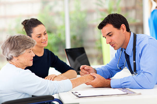 dermatologist inspecting senior patient skin - dermatology stock photos and pictures