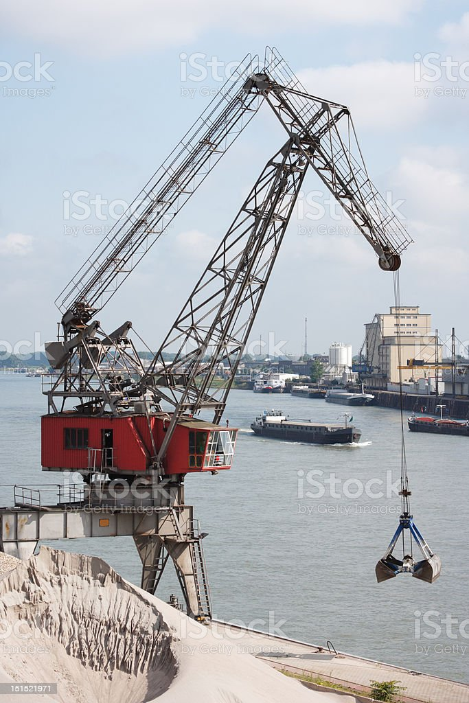 derrick and barge at Rhine River, Mannheim, Germany stock photo