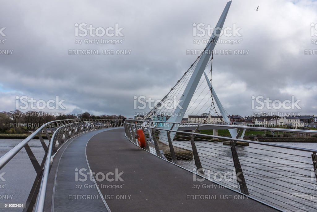 Derry, Northern Ireland - March 28th 2015 : Peace Bridge over the River Foyle. stock photo