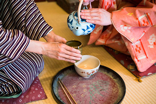 dertail of having traditional japanese tea in kyoto japan - ceremonie stockfoto's en -beelden