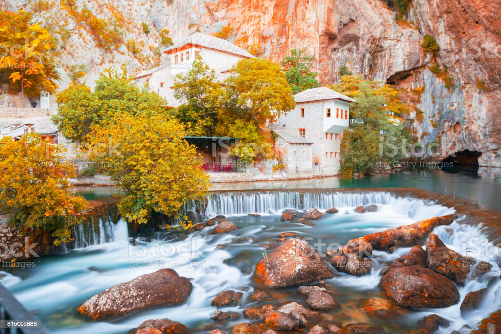 Dervish house on Buna spring with a small waterfall and a cave nearby in a sunny summer day in Blagaj, Bosnia and Herzegovina stock photo