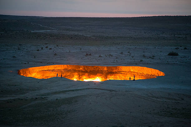 Derweze Gas Crater known as 'The Door to Hell',Turkmenistan Derweze Gas Crater known as 'The Door to Hell' in the early morning,Turkmenistan known gas stock pictures, royalty-free photos & images