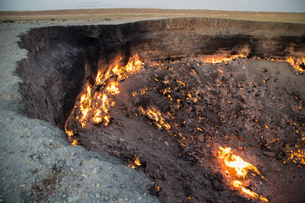 Derweze Gas Crater known as 'The Door to Hell',Turkmenistan Derweze Gas Crater known as 'The Door to Hell' in the daytime,Turkmenistan known gas stock pictures, royalty-free photos & images