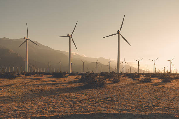 Desaturated Wind Turbines Desaturated Palm Springs windfarm. desaturated stock pictures, royalty-free photos & images
