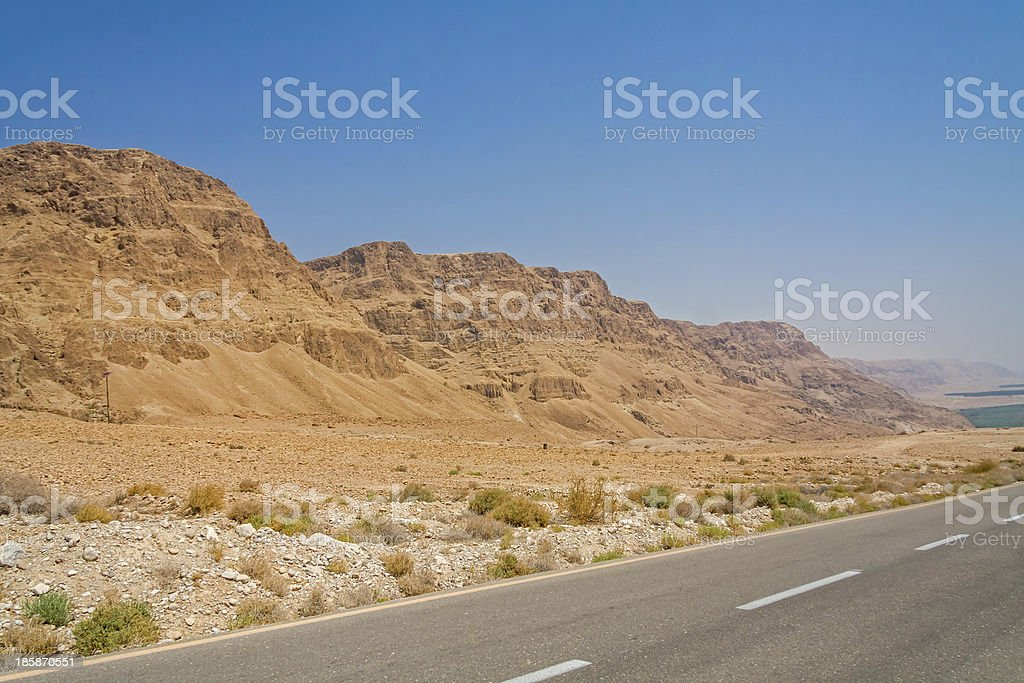 Descend highway on mountain slope along Dead Sea shore royalty-free stock photo