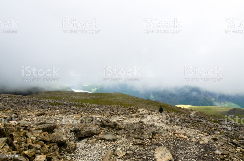 Descending Scafell Pike as amongst the clouds stock photo