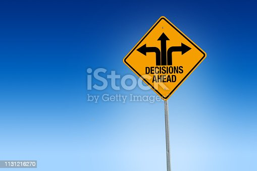 istock Descisions ahead road sign in warning yellow with blue background, - Illustration 1131216270