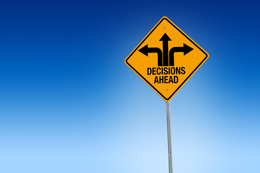 Descisions Ahead Road Sign In Warning Yellow With Blue Background Illustration Stock Photo - Download Image Now