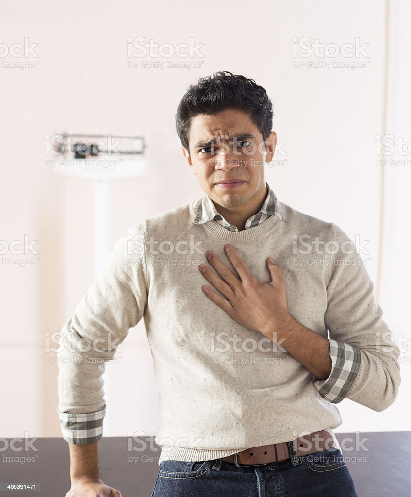 Describing symptoms in a doctor's office stock photo