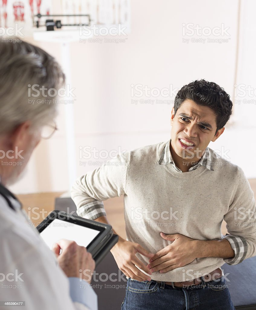 Describing symptoms to a doctor stock photo