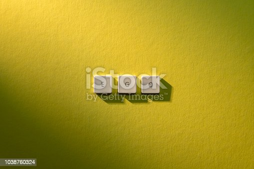 istock description of the word Ego on yellow background 1038760324