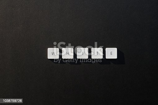 613303142 istock photo description of the word White with keyboard letters on black background 1038759726