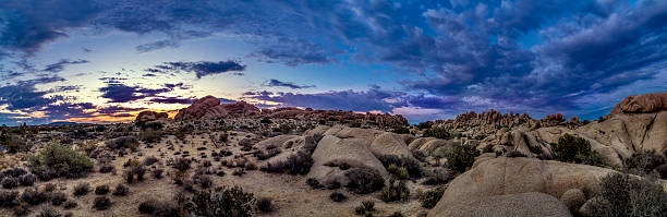 Desert at Night or Golden Hour Desert scene turing into night during sunset also called golden hour.  The sun has jsut set over the horizon so the skiles are vibrant with colors.  The image depicts nature and national parks in the Western America. mojave desert stock pictures, royalty-free photos & images