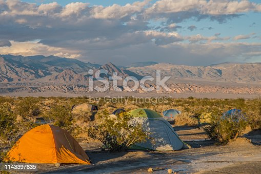 As the sun sets the view from a desert campsite can change to dramatic sunsets. Death Valley National Park has vast and beautiful views.