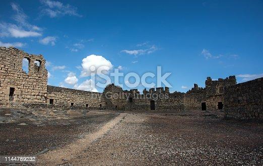 Desert castle Qasr al Azraq in eastern Jordan under clear blue skies