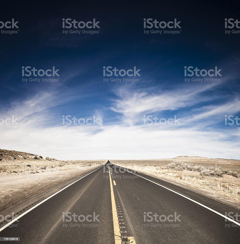 Desert Country Road Vivid Blue Sky royalty-free stock photo