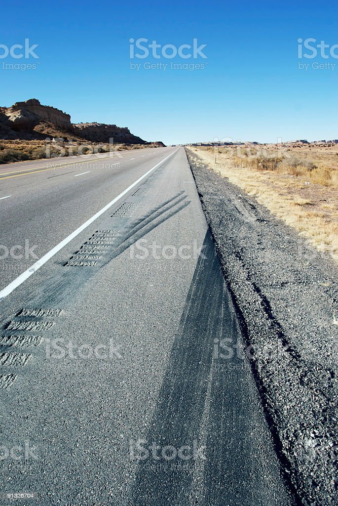 desert freeway skid marks shoulder royalty-free stock photo