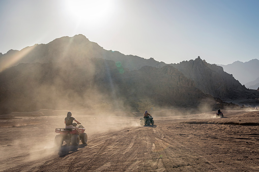 Desert in Africa. ATV safaris. Excursions in Egypt. sharm-el-sheikh. Tourists have fun on quad bikes in the wild desert. Bike safari. Extreme sports in the summer.