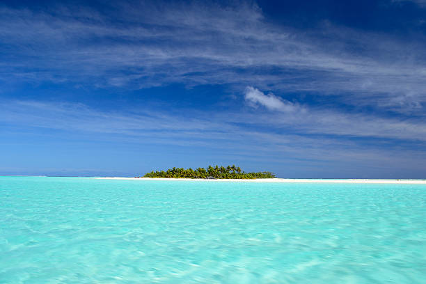 desert island in turquoise water - desert island stock photos and pictures